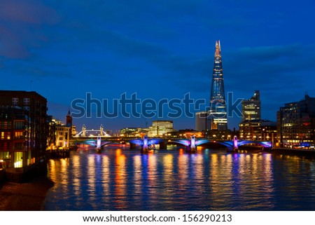 London cityscape with Southwark Bridge and The Shard skyscraper - stock photo