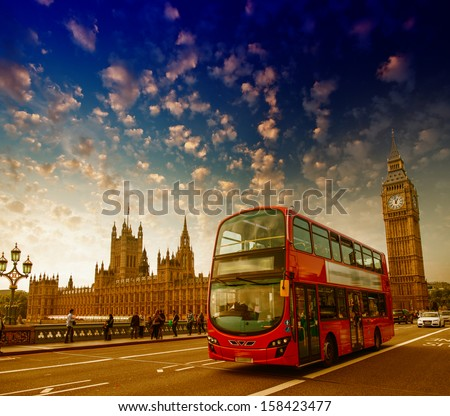 London. Classic red double decker bus crossing Westminster Bridge at sunset. - stock photo