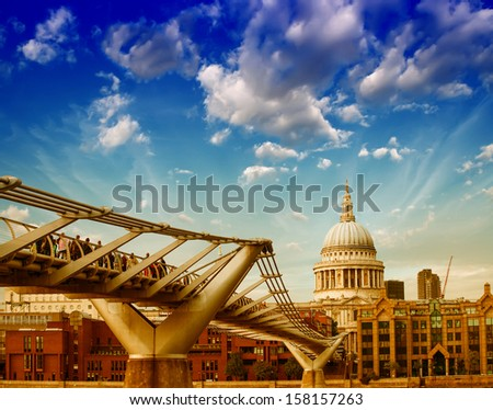 London. Colourful sky above St Paul Cathedral and Millennium Bridge. - stock photo