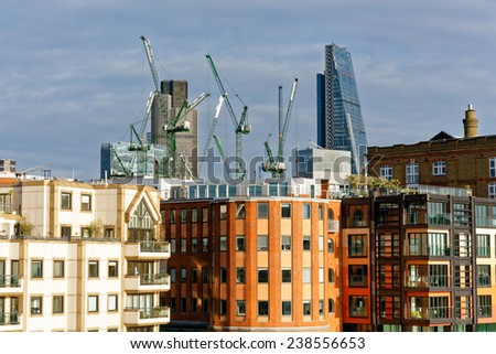 LONDON - DEC 14 : London cityscape and the Southwark riverside, pictured on December 14th, 2014, in London, UK. Charles Dickens set several of his novels here where he lived as a young man.  - stock photo