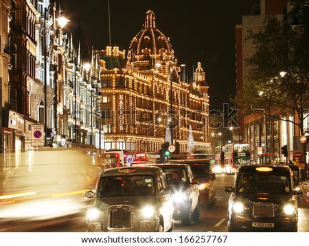 LONDON - DEC 3 : Night View of Harrods with christmas decoration on Dec 3, 2013, London, UK. This department store was opened at 1824 and now it is one of the most famous luxury store in London. - stock photo