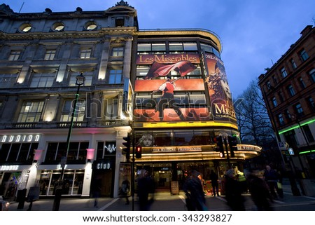 LONDON - DEC 10: Outside view of Queen's Theatre, West End theatre, located on Shaftesbury Avenue, City of Westminster, since 1907, designed by W.G.R. Sprague. at night on Dec 10, 2012 in London, UK.  - stock photo