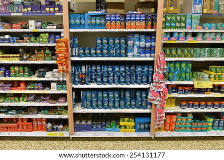 LONDON - DEC 12: Shelf view of a Tesco store on Dec 12, 2014 in London, UK. Britain's Tesco is the world's third largest supermarket chain retailer after America's Walmart and France's Carrefour. - stock photo