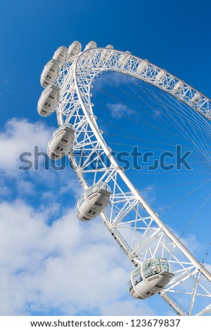 LONDON - DEC 2: The London Eye on December 2, 2012 in London. The entire structure of the London Eye is 135 meters tall and the wheel has a diameter of 120 metres. - stock photo