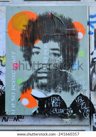LONDON - DECEMBER 28. Poster of Jimi Hendrix in a yard just off Brick Lane at Shoreditch in the Borough of Tower Hamlets on December 28, 2014, an area renown for its street art in east London, UK. - stock photo