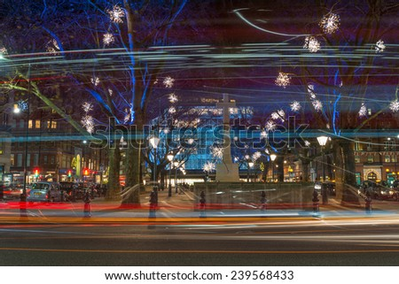 LONDON - DECEMBER 21st 2014: Christmas Lights Display on Duke of York Square just off the fashionable King's Road in Chelsea, London, a lovely pedestrianized area just off Sloane Square - stock photo