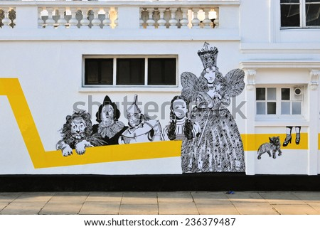 LONDON - DECEMBER 6. Temporary street art on the facade of Chelsea Arts Club featuring characters from the 1939 American film The Wizard of Oz, on December 6, 2014; located in Chelsea, London. - stock photo