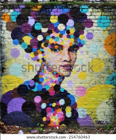 LONDON - DECEMBER 28. Wall painting on December 28, 2014, in a yard off Brick Lane, Shoreditch, in the Borough of Tower Hamlets, an area renown for its street art in London, UK. - stock photo