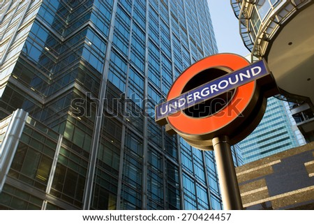 LONDON ENGLAND - APRIL 14, 2015: london underground sign -logo for tube  in the office zone, Canary Wharf. - stock photo