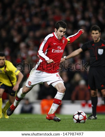 LONDON, ENGLAND. 31/03/2010. Arsenal player Cesc Fa?bregas (captain) taking and scoring a penalty  during the  UEFA Champions League quarter-final between Arsenal and Barcelona at the Emirates Stadium - stock photo