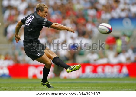 LONDON, ENGLAND. 06 AUGUST 2011  Jonny Wilkinson playing for England, kicks a drop goal during the rugby union Investec International between England and Wales at Twickenham Stadium. - stock photo