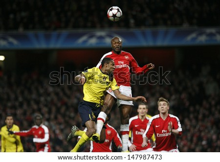 LONDON, ENGLAND. 31/03/2010. Barcelona player Seydou Keita and Arsenal player William Gallas during the  UEFA Champions League quarter-final between Arsenal and Barcelona at the Emirates Stadium - stock photo