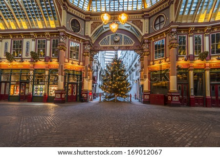 LONDON, ENGLAND DEC 29:Christmas decorations in Leadenhall Market (the building was designed at the end of the 19h century by Sir Horace Jones) on Dec 29, 2013 in London, UK - stock photo