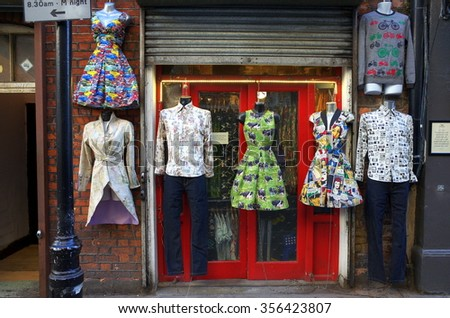 London, England - December 28, 2015: Mannequins wearing printed fashion design clothing hanging outside an unnamed shop in the Soho district of London, England.  - stock photo