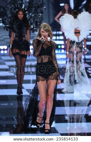 LONDON, ENGLAND - DECEMBER 02: Singer Taylor Swift performs during the 2014 Victoria's Secret Fashion Show on December 2, 2014 in London, England. - stock photo