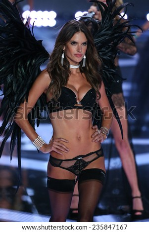 LONDON, ENGLAND - DECEMBER 02: Victoria's Secret model Alessandra Ambrosio walks the runway during the 2014 Victoria's Secret Fashion Show on December 2, 2014 in London, England. - stock photo