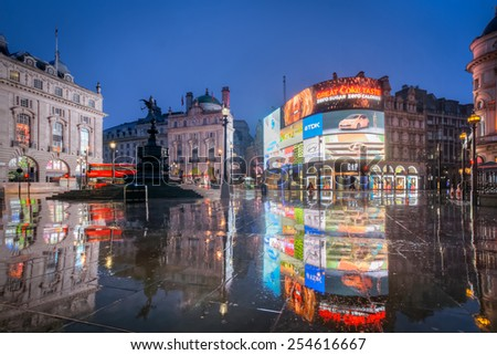 LONDON, ENGLAND FEB 21: Famous Piccadilly Circus neon signage that is a major attraction of London on Feb 21, 2015 in London, United Kingdom - stock photo