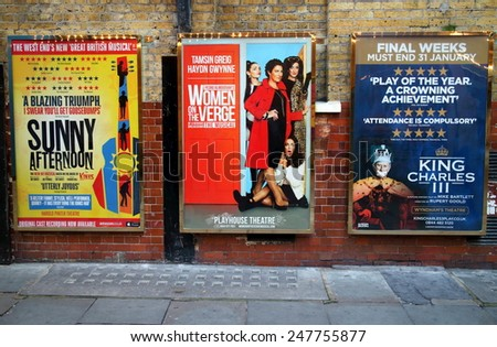 London, England - January 24, 2015: Billboard posters on a brick wall advertising musicals and plays in the West End of London.  In 2013, ticket sales for London theatres  were in excess of 500m  - stock photo