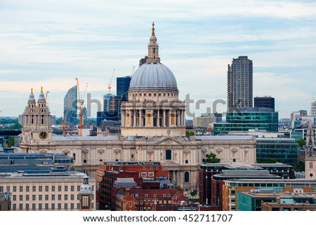 LONDON, ENGLAND - JULY 03,2016.LONDON, ENGLAND - JULY 03,2016. View from a tall building of the imposing St Paul's Cathedral in the City of London. - stock photo