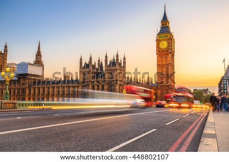 LONDON, ENGLAND - JULY 03,2016. London scenery at Westminter bridge with Big Ben and at sunset blurred red bus, UK. - stock photo