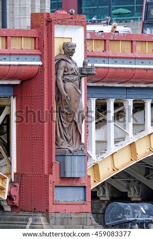 LONDON, ENGLAND - JULY 8, 2016: Statue representing Architecture on a pier of Vauxhall Bridge over the River Thames in London. Sculpted by the late Frederick Pomeroy and on permanent public display. - stock photo