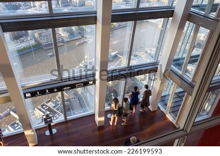 LONDON, ENGLAND - JULY 15: Visitors on the viewing platform of the Shard on July 15, 2014 in London, England - stock photo
