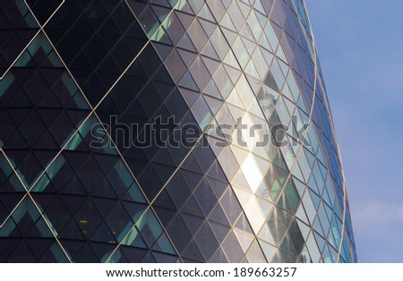 London, England - June 30, 2013: A close up view of the Gherkin, 30 St. Mary Axe. A Norman Foster modern glass and steel building in London's main financial district on June 30th 2013 - stock photo