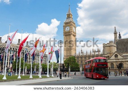 LONDON, ENGLAND - JUNE 1, 2014 - Big Ben Clock Tower and Westminster abbey with red double-decker bus - stock photo