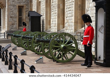 LONDON, ENGLAND - JUNE 12, 2015: Guards at Tower of London. British The Queen's Guard in their red uniforms and fuzzy black hats are among the most famous in the world. - stock photo
