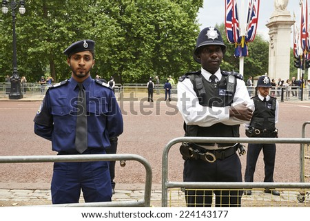 LONDON, ENGLAND - June 07, 2014: Heavily armed police officers on Guard near Buckingham Palace, London for Trooping the Colour in London, England the 07 june 2014 - stock photo