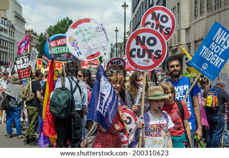 LONDON, ENGLAND - JUNE 21, 2014: Protesters campaigning against the Coalition Government gathering in central London before taking part in the People's Assembly march through central London. - stock photo