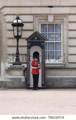 LONDON, ENGLAND- JUNE 21: Sentry of the Grenadier Guards posted outside of Buckingham Palace on June 21, 2009 in London, United Kingdom.  The Grenadier Guards traces its lineage back to the year 1656. - stock photo