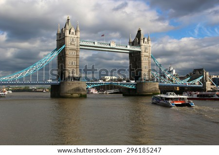 LONDON,ENGLAND,June 18, 2015: Tower bridge and boats on the River Thames in London, England, United Kingdom - stock photo