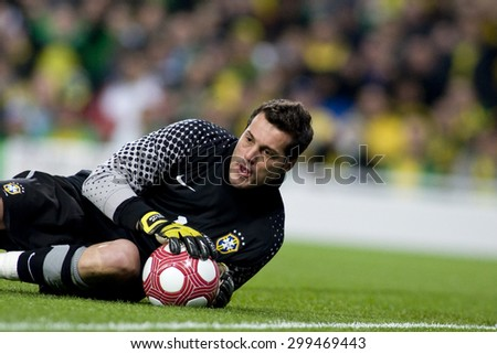 LONDON, ENGLAND. March 02 2010: Brazil's goalkeeper Julio Cesar makes a save during the international football friendly between Brazil and the Republic of Ireland played at the Emirates Stadium. - stock photo