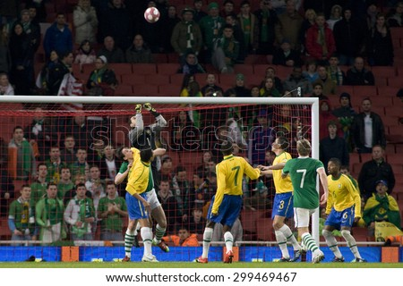 LONDON, ENGLAND. March 02 2010: Brazil's goalkeeper Julio Cesar punches the ball clear during the international football friendly between Brazil and the Republic of Ireland - stock photo