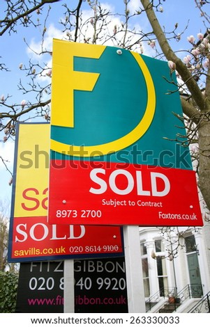 London, England - March 24, 2015: Estate agent signs outside a row of terraced houses in London, England. Average house prices fell by 0.2% in January 2015, said the UK Office for National Statistics - stock photo