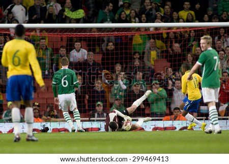 LONDON, ENGLAND. March 02 2010: Ireland's goalkeeper Shay Given stops a shot from Brazil's Robinho during the international football friendly between Brazil and the Republic of Ireland - stock photo