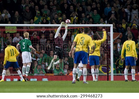 LONDON, ENGLAND. March 02 2010: Ireland's Shay Given makes a save during the international football friendly between Brazil and the Republic of Ireland played at the Emirates Stadium. - stock photo