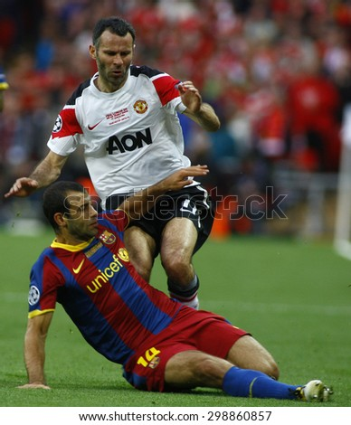 LONDON, ENGLAND. May 28 2011: Barcelona's midfielder Javier Mascherano and Manchester's midfielder Ryan Giggs during the 2011UEFA Champions League final between Manchester United and FC Barcelona - stock photo