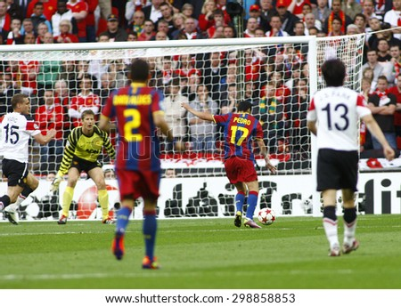 LONDON, ENGLAND. May 28 2011: Barcelona's midfielder Pedro Rodr�¢??guez scores  the first goal during the 2011UEFA Champions League final between Manchester United and FC Barcelona, at Wembley Stadium - stock photo