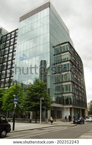 LONDON, ENGLAND - MAY 13, 2014: Headquarters of mobile 'phone company Everything Everywhere at The Point, Paddington Basin, London.  The modern building was designed by the architect Terry Farrell. - stock photo