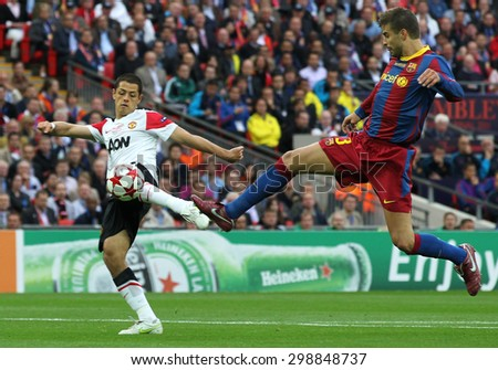 LONDON, ENGLAND. May 28 2011: Manchester's forward Javier Hernandez and Barcelona's defender Gerard Piquet during the 2011UEFA Champions League final between Manchester United and FC Barcelona - stock photo