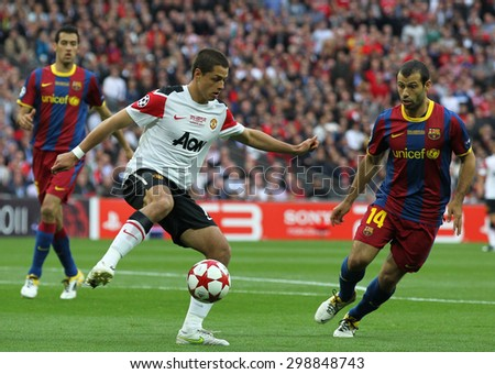 LONDON, ENGLAND. May 28 2011: Manchester's forward Javier Hernandez and Barcelona's midfielder Javier Mascherano during the 2011UEFA Champions League final between Manchester United and FC Barcelona - stock photo