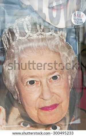 LONDON, ENGLAND - MAY 30: Queen Elizabeth II Celebrity Face Mask in a souvenir gift shop on May 30, 2015 in London - stock photo