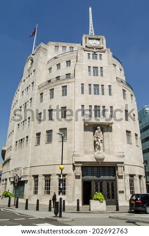 LONDON, ENGLAND - MAY 18, 2014:  The BBC headquarters at Broadcasting House in central London.  The television presenter Andrew Neil is walking in front of the building. - stock photo