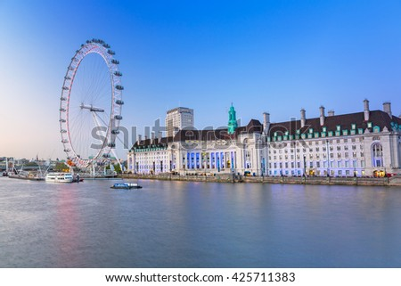 LONDON, ENGLAND - May 14, 2016 : The London Eye near the River Thames  in London at dusk, England. The London Eye is a giant Ferris wheel on the South Bank of the River Thames in London. - stock photo