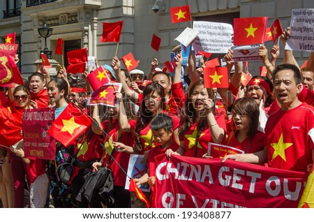 LONDON, ENGLAND - MAY 18, 2014:  Vietnamese protesters demonstrating against China moving an oil rig into disputed waters. - stock photo