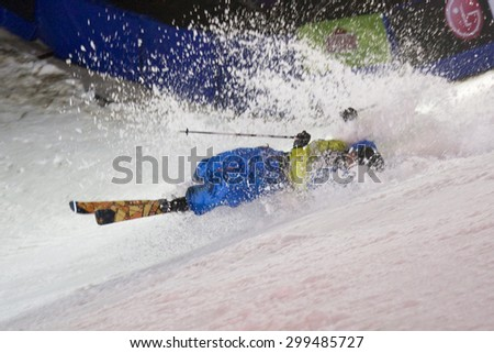 LONDON, ENGLAND. October 30 2009 A competitor crash lands during the skiers vs snowboarders exhibition competition at the London Freeze snowboard and freestyle skiing event. - stock photo