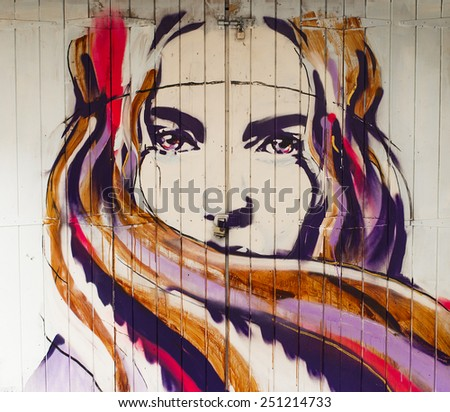 London, England - October 14, 2014: Beautiful girl mural in Camden Town - stock photo