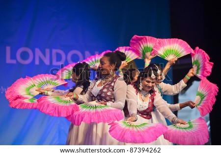 LONDON, ENGLAND - OCTOBER 16: Unidentified female dance group perform live at the Diwali religious Festival of Light in Trafalgar Square on October 16, 2011 in London, England. - stock photo